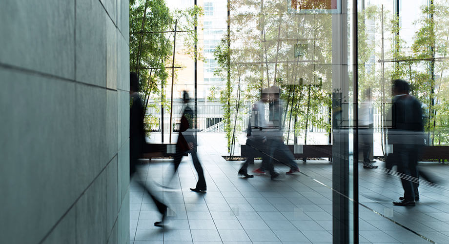 People walking in an office building